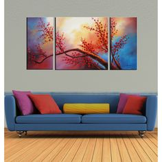 Art enthusiasts will adore this three-canvas hand-painted oil art. Plum Blossom is a stunning piece that depicts nature in vibrant shades of red, blue, violet, and yellow. This painting features mounted hangers, so it arrives ready to hang.