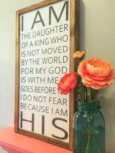 I AM the Daughter of a King sign with custom colors: 12x22x1.5 Pictured item is shown with White Background, Gray Lettering and Walnut frame. This item is handmade right on the farm here in Idaho. Full of that farmhouse chic, Fixer-Upper style that were all craving. Customize your wood sign with your choice of lettering color and frame stain options. Perfect for any room of the house! Here at Huckleberry Avenue our made-to-order signs are made of real wood and hand painted, followed by a…