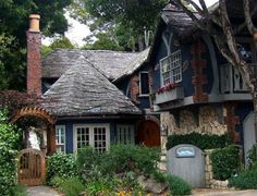 Wonderful fairy tale cottage. Stone and blue two-story cottage home.
