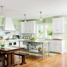 Sea foam walls, wood and stainless steel make a very pretty kitchen.