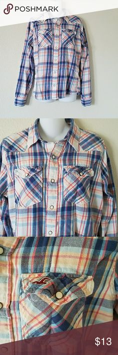 Hollister women's flannel button shirt size M Hollister women's flannel button shirt size medium. Long sleeves, two fromt pockets. In blues reds and light peach color plaid. Hollister Tops