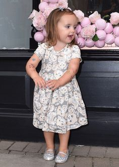 Sophia Ecclestone-Rutland (daughter of a British model, Tamara Ecclestone Rutland) Sporting a grey dress with teddy faces on it, teamed with silver shoes, she showed off her new markings — but thankfully, they were only temporary ones.