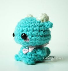 Mini Blue Monster - Kawaii Amigurumi Plush      This tiny monster stands just shy of 2 inches tall, by 1 1/2 inches at his widest. He is tightly