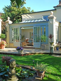 A stunning orangery featuring a rectangular roof lantern as part of the orangery roof