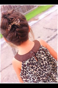 My baby's hairstyle for the day. Messy bun with upside French braid and a cute bow to add some fanciness <3