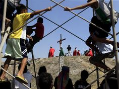 Filipinos view a scene of the re-enactment of the crucifixion of Jesus Christ on Good Friday in San Pedro Cutud village, San Fernando city, north of Manila, Philippines,  Ritchie B. Tongo, epa