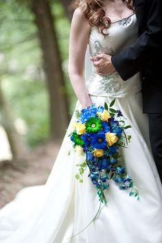 Royal blue and yellow bride bouquet.  Would prefer not to have the green but I like that it's not like a ball
