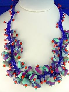 polymer clay beads made from scrap clay and strung on a peyote stitched neck piece.