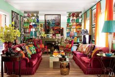 Brazilian architect and designer Sig Bergamin crafted a vibrant living room in his São Paulo home.