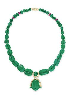 AN EMERALD BEAD, DIAMOND AND RUBY NECKLACE  Suspending an oval-shaped emerald bead with circular and single-cut diamond detail, joined by a rose-cut diamond link, to the graduated emerald bead neckchain with four ruby bead spacers, with a circular-cut diamond clasp, mounted in gold, 18¼ ins.