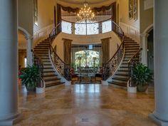 8 SOVEREIGN CIR RICHMOND, TX 77469: Photo Incredible double staircase.