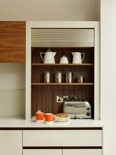 Kitchen cabinets - contemporary - London - Roundhouse. Appliance garage with roll-up door
