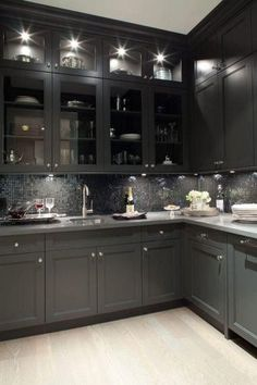 Grey kitchen cabinets. I normally like light kitchens, but there's something really sleek and sexy about this one.