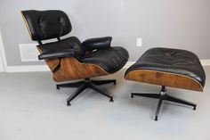 Authentic Charles & Ray Eames chair and ottoman in rosewood. Manufactured by Herman Miller in 1977. You will note from the pictures that the edges of