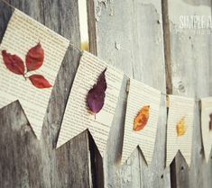 DIY fall garland. Glue pressed leaves onto pages from an old book.
