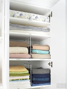 Slipping dividers onto closet shelves allows you to quickly build compartments that keep stacked clothing piles upright and separate. Although shown here in a bedroom closet, these dividers work equally well in linen closets as they form designated holding areas for sheets, towels, and blankets./