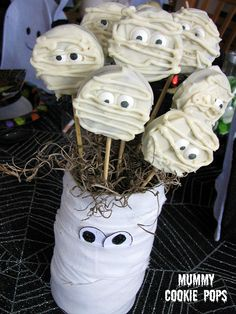 Cover Oreo cookies with white chocolate, add some eyes, and pipe white chocolate overtop.  And isn't everything always more fun when it is on a stick?