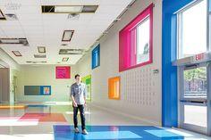 Vinyl floor tiles form color blocks to mimic windo reflections at West Preparatory Junior Public School in Toronto.   Taylor Smyth Architects.
