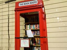 """The Clinton Community Library in New York has created the Book Booth — a re-purposed, vintage, English model K8 telephone box that now exists as a community book exchange. It even lights up at night! Creators encourage """"readcycling"""" and like most micro libraries, request that if you take a book you leave one as well."""