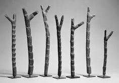 Africa | Dogon People, Mali | Miniature Ladders | Wood | h. 42.7 cm., w. 2.8 cm., d. 2.4 cm. (16 13/16 x 1 1/8 x 15/16 in.)