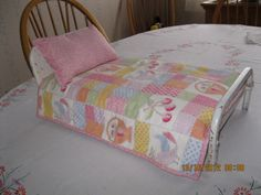 painted metal doll bed with hand-made bedding