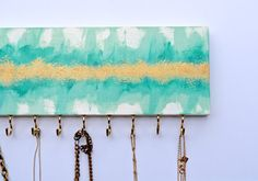 This jewelry hanger is a small piece of art, but oh so practical with 15 hooks for accessories. Abstract painting with gold detailing.
