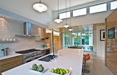 This Miami kitchen is the perfect space for entertaining! Bright, modern and LEED certified design by Balfoort Architecture, Inc. Photo by Rosky & Associates, Inc. The use of color and light makes for a truly stunning kitchen design.