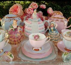 Don't forget you can bring out accessories to adorn your tea party table.  I love these figurines on the table.