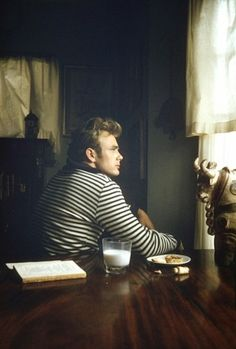 James Dean, looking out a window...a book, milk and cookies, a homey kitchen with a cow table accent
