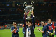 Barcelona's coach Luis Enrique celebrates with the trophy after the UEFA Champions League Final football match between Juventus and FC Barcelona at the Olympic Stadium in Berlin on June 6, 2015. FC Barcelona won the match 1-3