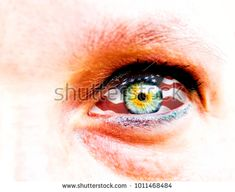 soft focus and close up of a green yellow woman eye isolated on a white background with usa flag in the iris
