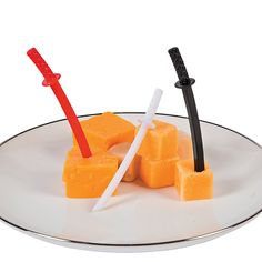 Ninja Sword Food Picks - OrientalTrading.com  not quite sure how to use this for a kids party, but this may come in handy.