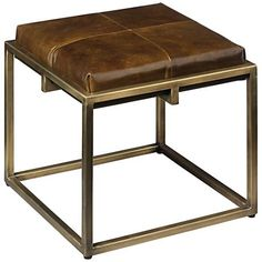 Rich olive brown leather is a perfect match with the antique brass finish base of this modern, open-cube design metal stool from Jamie Young.