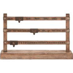 Wood calendar decor.      Product: Calendar decor  Construction Material: Wood and metalColor: Light ...