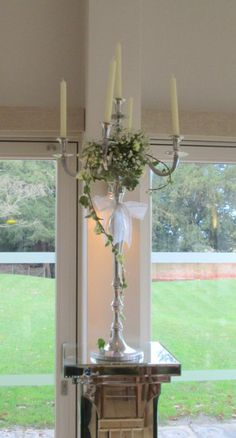 Candelabra display of gyp with spray rose and ivy