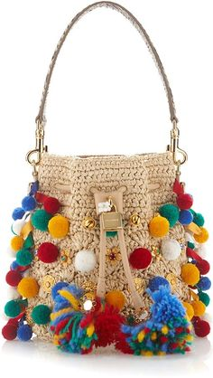 Shop Claudia with Pom Poms Bucket Bag. This Spring Summer 16 collection is rife with Sicilian references, manifested in spring's elaborate Renaissance emblems, majolica ceramic heels, and pom-pom embellishments. Crochet Handbags, Crochet Purses, Crochet Bags, Spring Handbags, Mini Handbags, Bucket Handbags, Leather Handbags, Gilet Crochet, Crochet Shoulder Bags