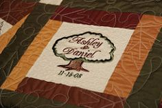 Q is for quilt.   This is our wedding guest book quilt:    My husband's second cousin Mary Clare made this for us.  She is a very talented q...