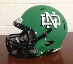 North Dakota new matte green football helmet College Football Helmets, Football Usa, Notre Dame Football, Football Stuff, American Football, Fighting Sioux, Fighting Irish, Noter Dame, Touchdown Jesus