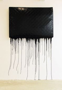 Jim Lambie, Black Metal, 2004, mattress saturated with gloss paint