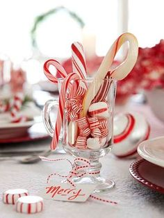 Keep it simple. A bit of red and white candy in a glass jar or mug with a little ribbon is very festive and inexpensive.