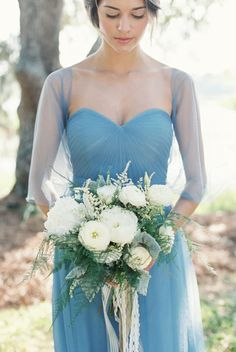 absolutely love this bridesmaid dress. Beautiful icy winter blue bridesmaid dress and white bouquet