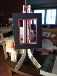 Hockey easels for centerpieces...this would be great for a certain groom's cake table..