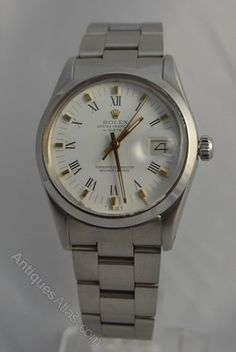 A 1982 Rolex Oyster Perpetual Date wristwatch. A stainless steel case and Oyster bracelet. A white dial with gilt hour markers and Roman numerals, subsidiary date and sweep seconds. A superlative chronometer movement. Quick date set. Caliber 3035 automatic movement. Ref 15000. Original Rolex box and