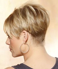 The back of this do is clipper cut then graduated up to the crown and sides with jagged cut layers blending into the top. The crown is styled with height and lift making a fab 'do to balance out a round face.