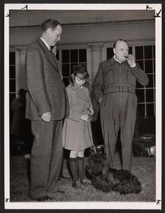 Winston Churchill outside the White House with Roosevelt emissary Harry Hopkins and his daughter, Diana, and Fala, the president's Scotch terrier.