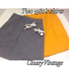 Two 1980's skirts. Grey knit jersey . Elastic waist - pleated front and 2 side pockets. Used no rips tears or stains. This was hand made - no tags. Waist 26, hips 36 and length 18.5 inches. Gold knit jersey , elastic waist, kick slit in back. Used no rips tears or stains, no tags. Waist 26 hips 36 and length 19 inches. Handmade vintage. Vintage Dresses