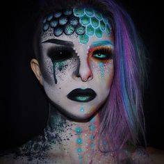 """October 18th: A mermaid who had a spell cast on her and is turning evil. Her colours begin to fade and the darkness creeps in. ✖️ Used #Mehron Paradise paint, #NYX Primal Colours in Hot Black, Pink & Orange. NYX Mermaid shadow, NYX Black & White Liquid liners, #Makeupforever Flash palette, Starlette Lashes from #HouseofLashes ✖️ #Holoween2015"" Photo taken by @kimberleymargarita_ on Instagram, pinned via the InstaPin iOS App! http://www.instapinapp.com (10/18/2015)"