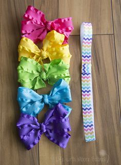 A Rainbow Chevron Headband with 5 Ruffle Bows in coordinating colors is a great accessory for all the little girls in your life. Stretchy fold over elastic in a bright rainbow chevron pairs great with our hot pink, yellow, green, bright blue, and purple ruffle bows. The headband is hand sewn, and made with a loop where you can add a hair bow. Each hair bow is mounted on an alligator clip that is partially lined with ribbon. All ribbon ends are heat sealed to prevent fraying. The hair bows…