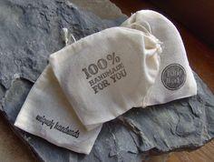 Muslin drawstring bags, hand-stamped.