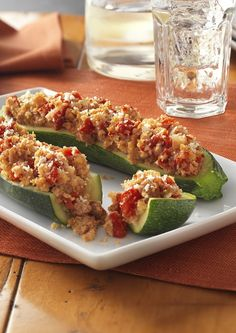 Zucchini shells stuffed with a mix of Italian sausage, tomatoes, zucchini and onions, then topped with KRAFT Cheese. Serve this dish at your next dinner party and your guests will be begging for the recipe!